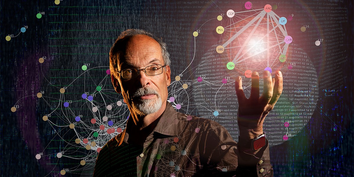 Gustavo Caetano-Anollés surrounded by depiction of molecular networks