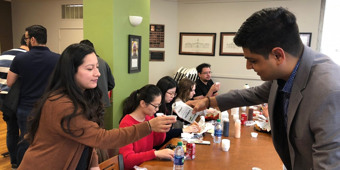 Gaur offers samples of his creamer to current students.