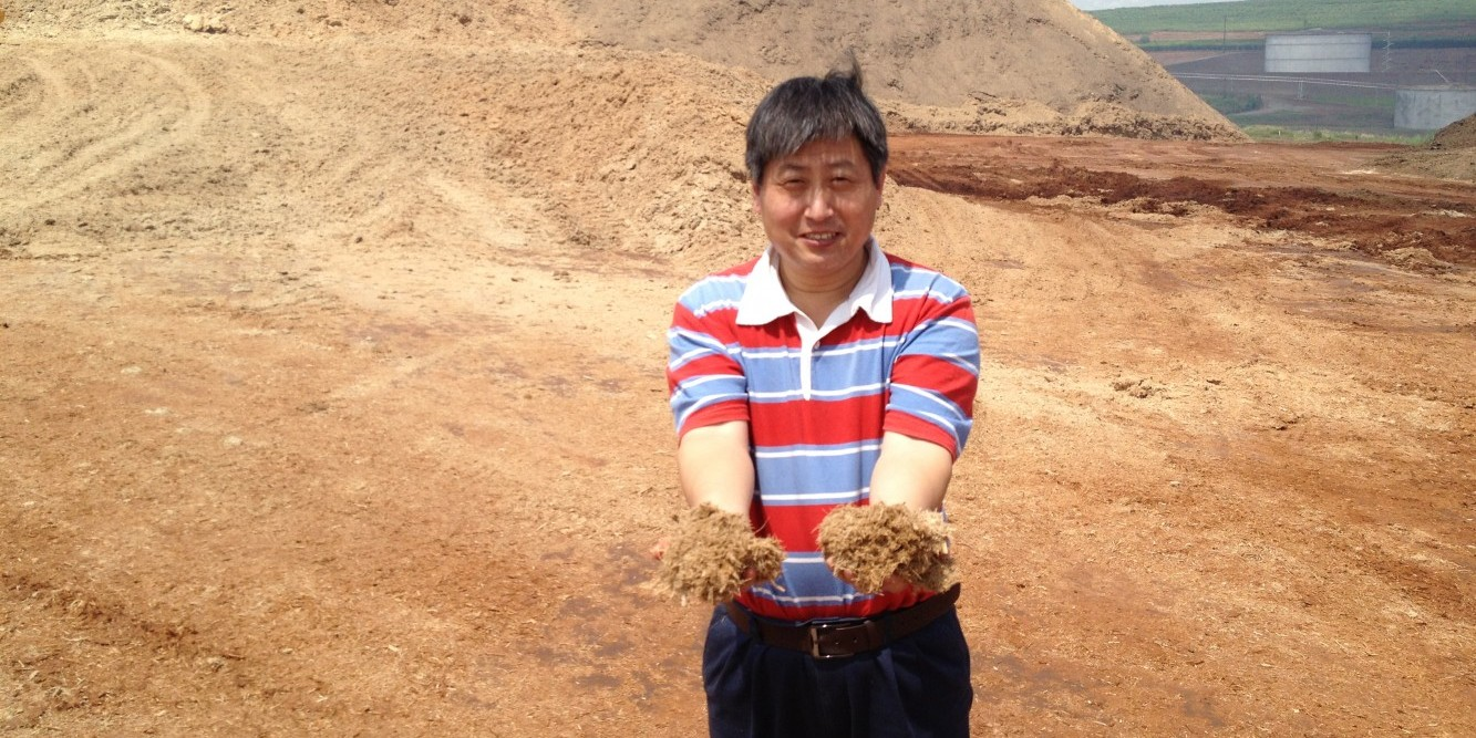 Zewei Miao with sugarcane bagasse in Brazil