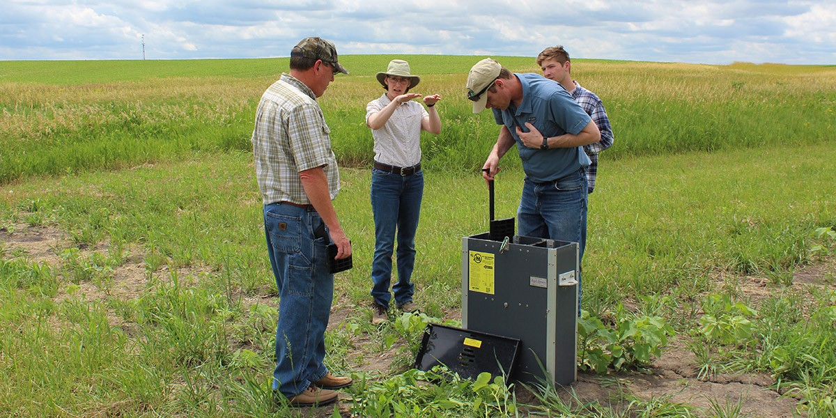 Laura Christianson (center) explains the inner workings of a saturated buffer