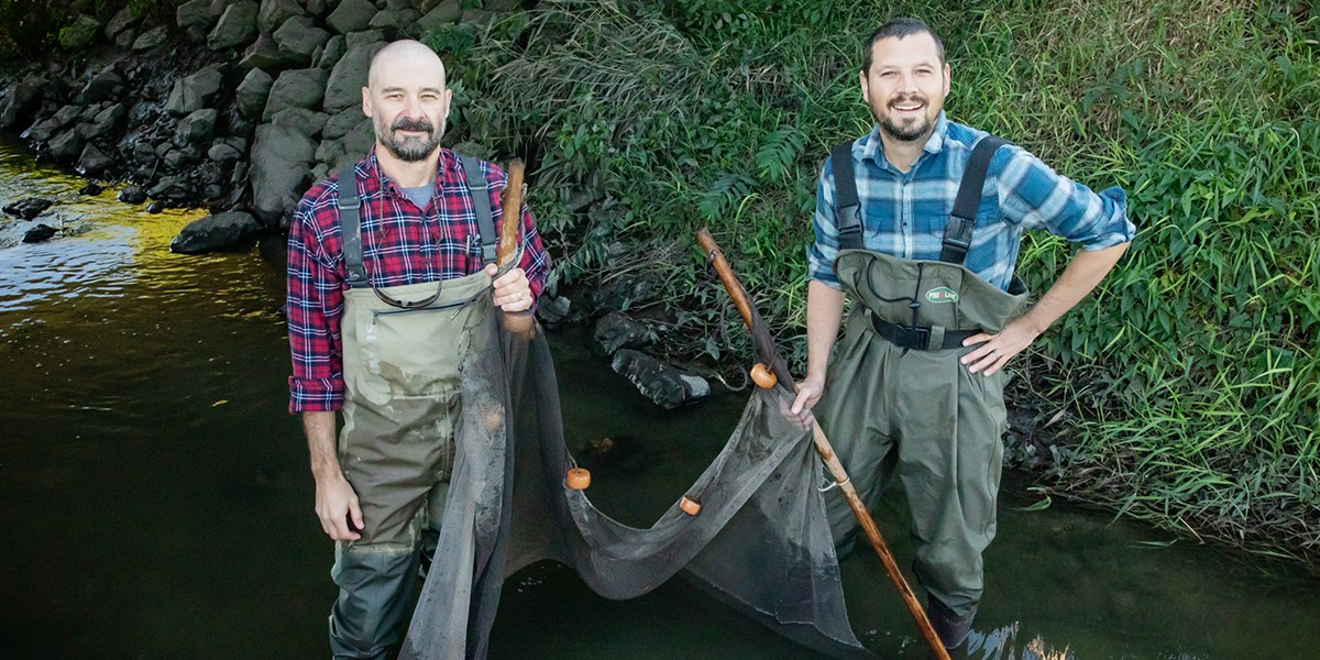 Christopher Taylor, left, Eric Larson and their colleague Zachary Rozansky, not pictured, report that an invasive crayfish is interbreeding with a native species in the Current River in Missouri.