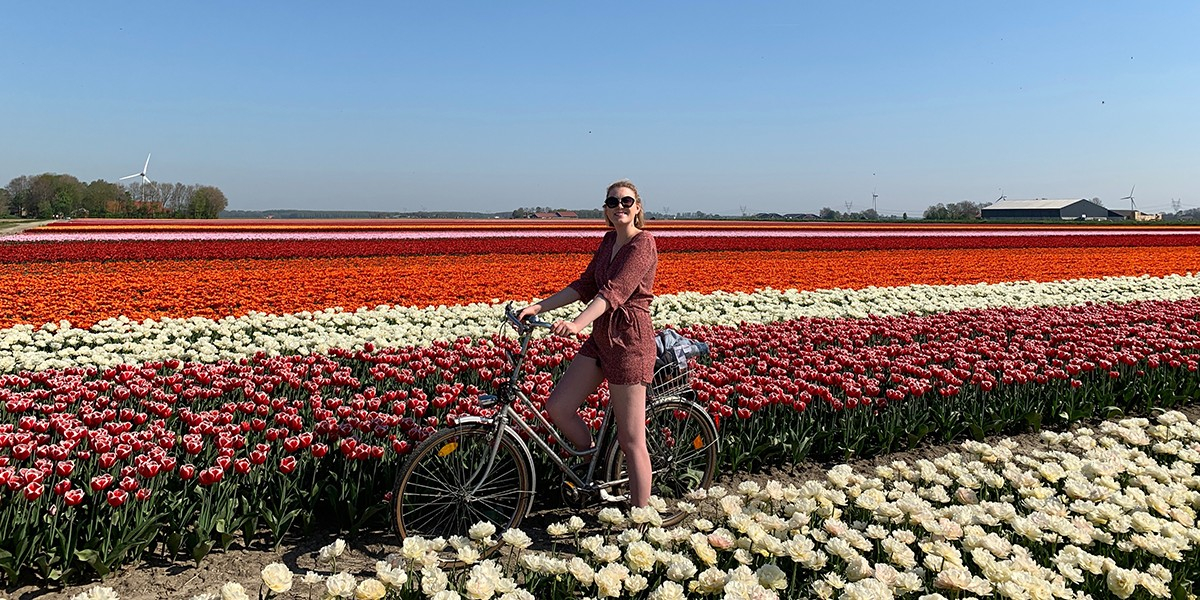 Meghan Selip in field of tulips.