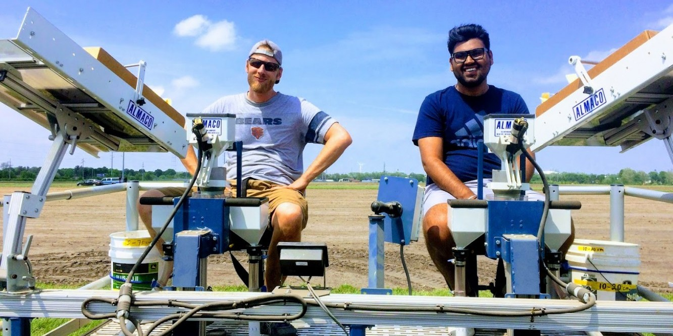 Nick Hausman and Daljeet Dhaliwal (right) in the field
