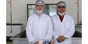 """Luis Ibarra (left) and Esau Giron Lopez, Ch.E., Production Coordinator for """"MUAQ"""" (right), at UAQ-Amazcala cheese processing plant."""