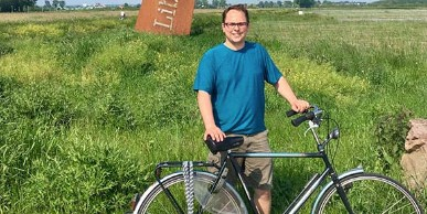 Photo of Martin Overholt with a bike.