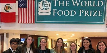 Photo of students under The World Food Prize banner.