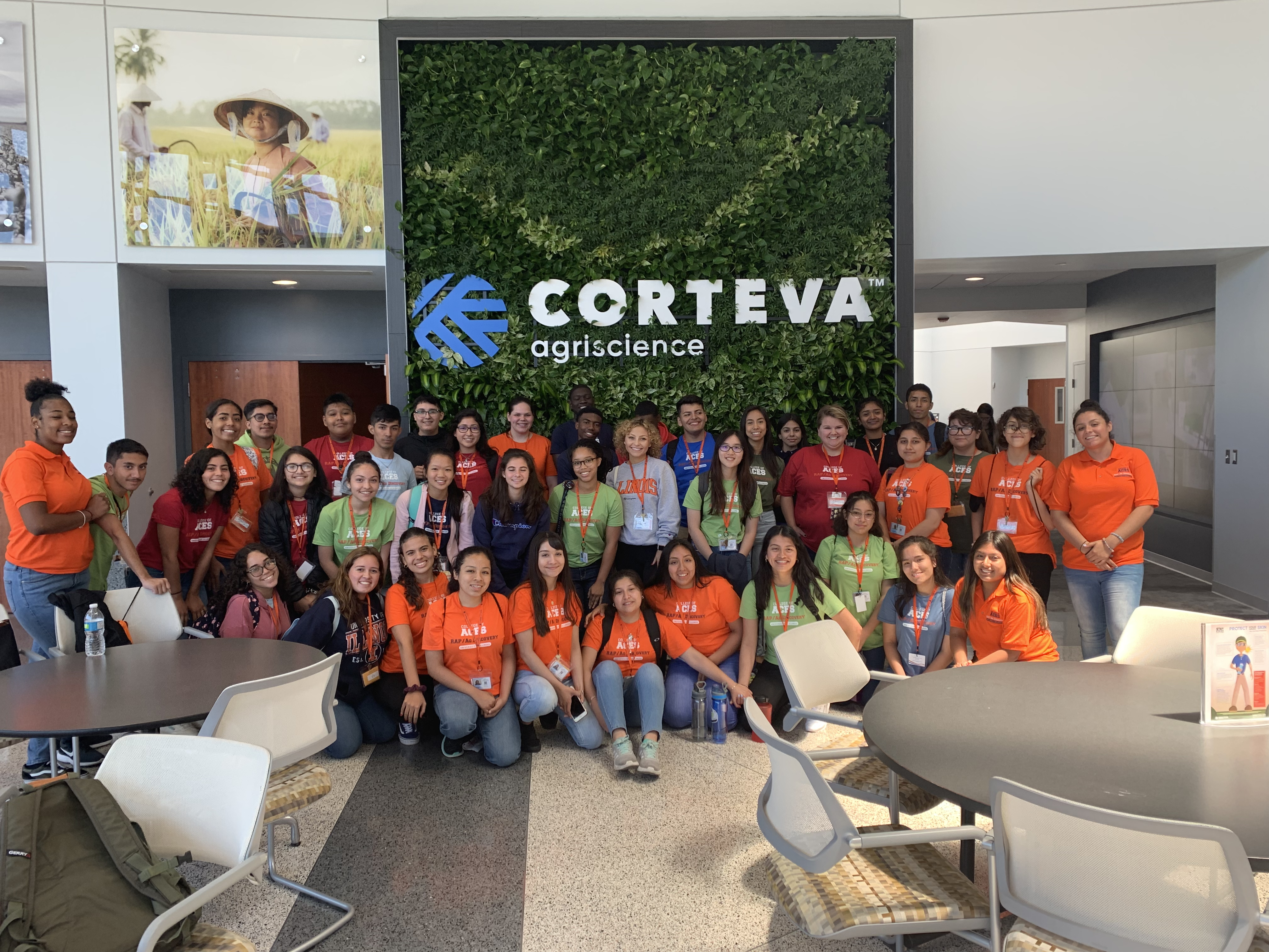 Group of students posing underneath Corteva sign