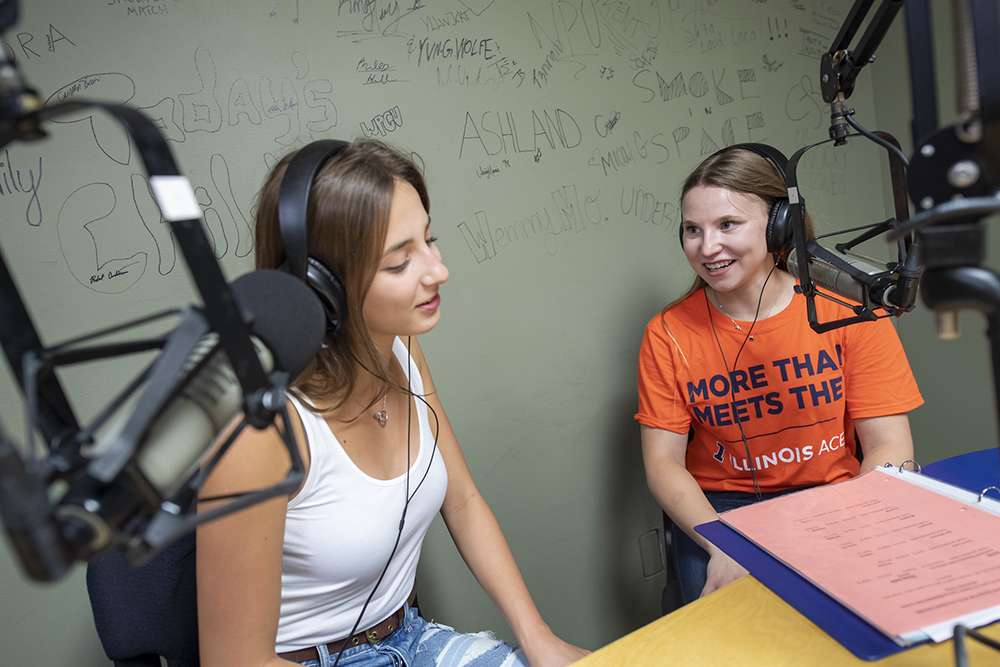 Two students talking in a studio audio setting
