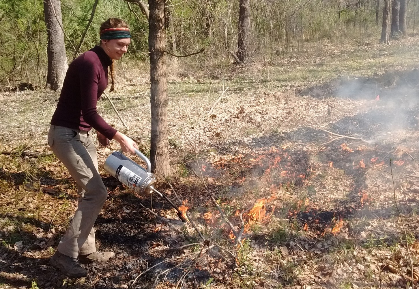 Study co-author Mara Rembelski applying fire to experimental plots