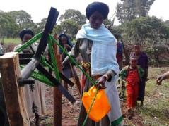 Women in Africa use labor and water saving irrigation mechanization tools in vegetable production.