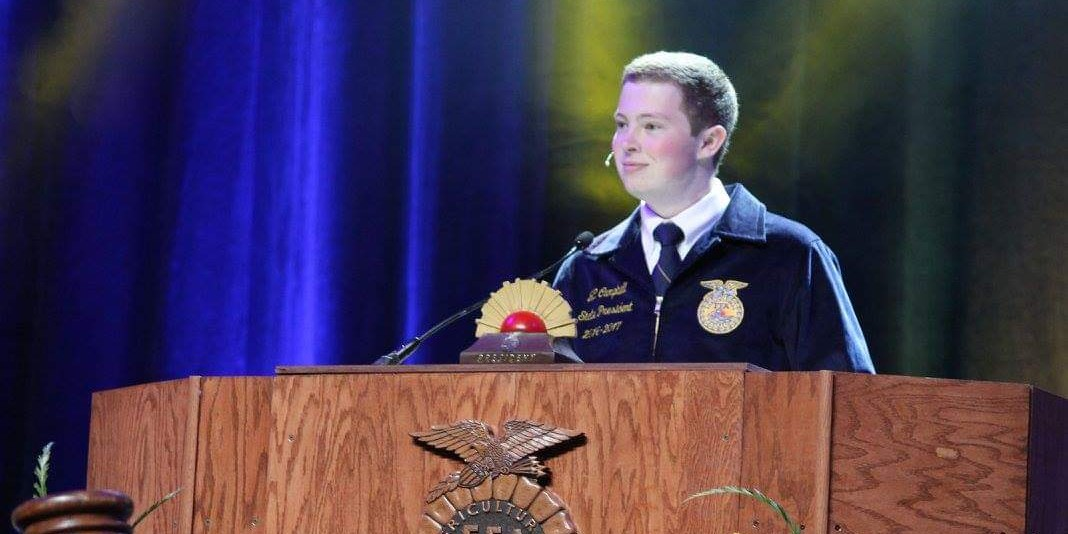student at podium speaking at FFA conference