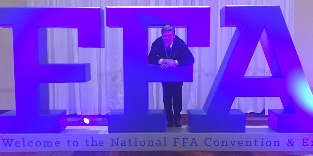 student with large FFA letters