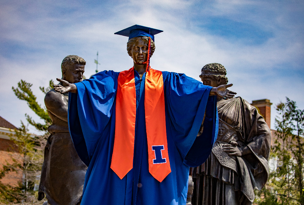 Alma Mater statue dressed in graduation gown and cap